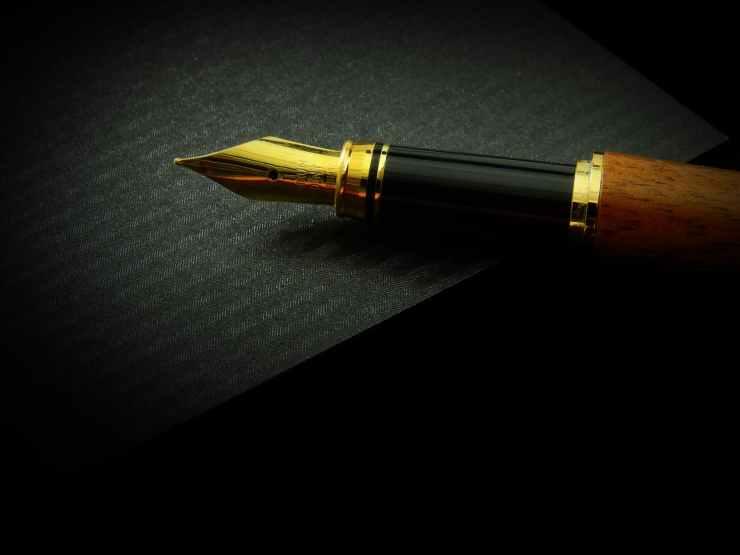 Gold-nib pen on a black paper.